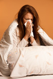 illness flu - Young Woman Lying On Bed Infected With Allergy Blo