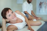 Woman receiving leg massage from physiotherapist