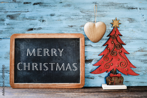 christmas tree and text merry christmas in a chalkboard плакат