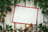 Christmas wooden background with spices and snow - copy space