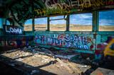 Inside of abandoned Washington bus with graffiti.