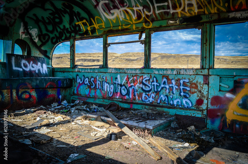 Inside of abandoned Washington bus with graffiti. Poster