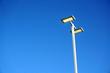 LED street lamp against blue sky