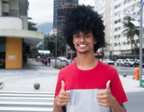 African american man with typical afro hair showing both thumbs - 128948694