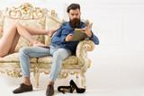 Bearded man and female legs