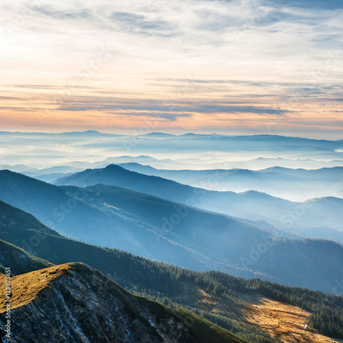 Fototapeta Blue mountains and hills over sunset