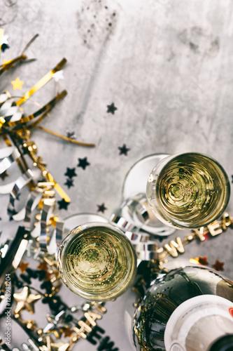 NYE: Champagne To Celebrate New Year On Grunge Background
