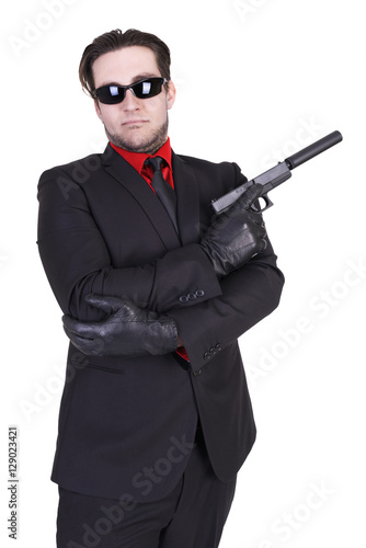 Handsome man holding gun, isolated on white background. Poster