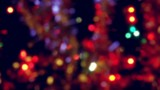 Holiday illuminated blurred Christmas lights and tinsel