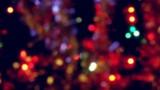 Holiday illuminated blurred Christmas lights and tinsel