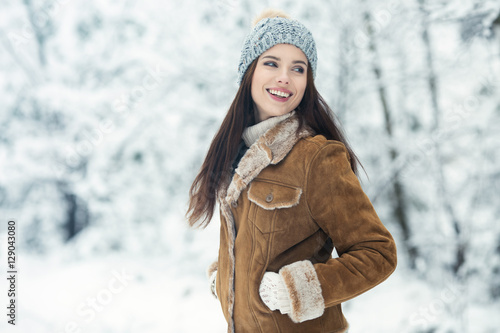 Foto Murales Happy young woman walking in winter time