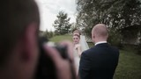 A photographer takes pictures of a beautiful young couple on their wedding day