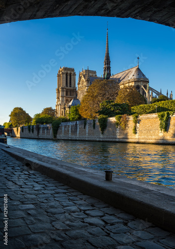 Notre Dame de Paris cathedral at sunset with the Seine River and Ile de La Cite. Paris, France Photo by Francois Roux