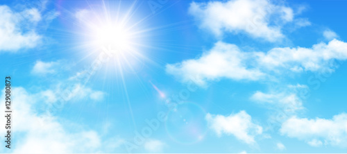 Sunny background, blue sky with white clouds and sun - 129080873