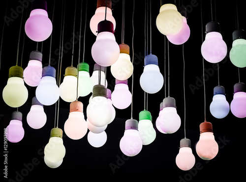 Color filter image/ Lighting ball hanging from the ceiling on the black background - 129097218