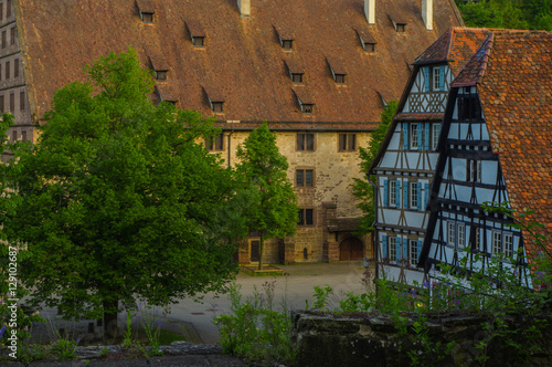 Poster MAULBRONN, GERMANY - MAI 17, 2015: row Tudor style houses at the monastery is part of the UNESCO World Heritage Site