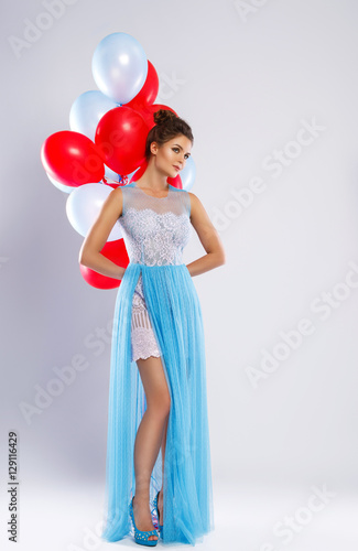 Poster Wwoman wearing beautiful dress with a lot of colorful balloons