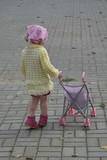 Girl with a toy stroller