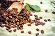 Roasted coffee beans with old wooden scoop. Coffee concept