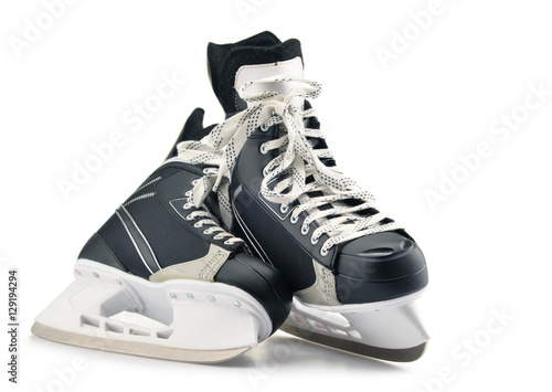 Pair of ice hockey skates isolated on white Poster