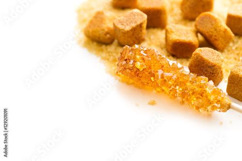 Brown amber sugar crystal on wooden stick. © Jiri Hera