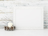 Horizontal interior mock up with candle and pine cones on empty wooden wall background. 3D rendering.