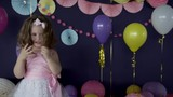 Cute little baby girl laughing and playing on her birthday party HD