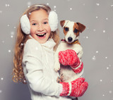 Girl in winter clothes with dog