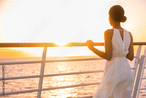 Poster Cruise ship vacation woman enjoying sunset on travel at sea