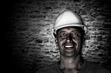 Portrait of a dirty and happy coal miner - 129236453