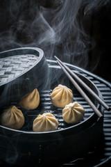 Enjoy your chinese dumplings in wooden steamer