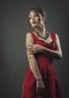 Young beauty in red dress woman studio shot fashion