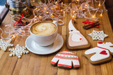Christmas gingerbread cookies and cup of coffee at yellow festiv