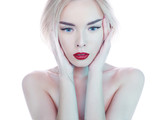 Beautiful blonde woman with perfect makeup red lips