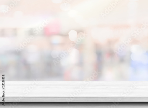 Wood table top on blurred shopping mall background. Used for display or montage your products - 129288838