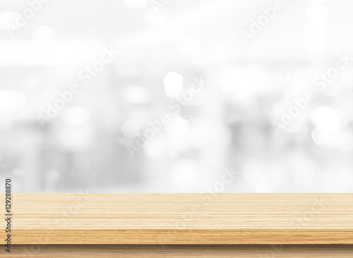 Wood table top on white blurred abstract background. Used for display or montage your products - 129288870