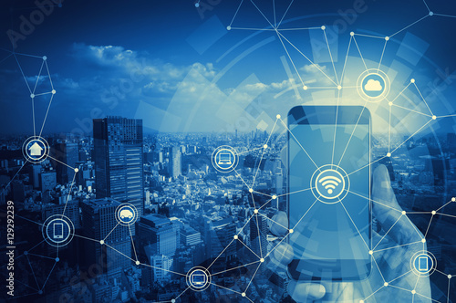 Poster duotone graphic of smart phone and smart city, wireless communication network