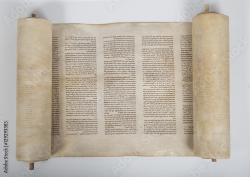 Plakat an ancient handwritten torah scroll