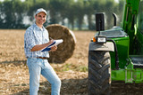 Farmer writing on a document - 129294667
