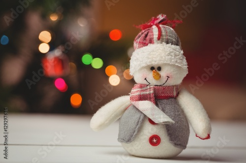 Close-up of snowman on wooden table