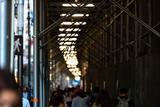 Pedestrians walking busy New York street ans a traffic sign