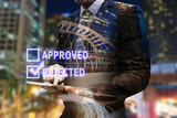 Double exposure businessman hand using digital tablet with check