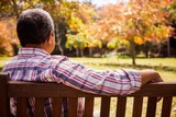 Thoughtful elderly man sitting alone on a bench