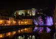 Isola del Liri waterfall and castle by night, Ciociaria, Italy