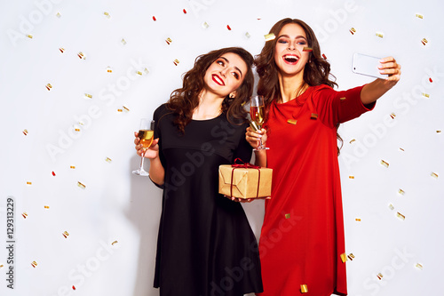 portrait of two happy young women who make selfie Poster