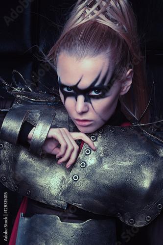 Poster Blond woman in steel armor posing