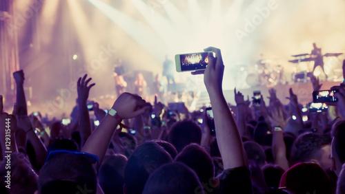 Fan taking photo of concert
