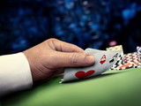 online poker player at casino table