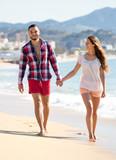 Couple on vacation walking on beach
