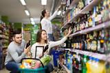 People choosing spirits in hypermarket